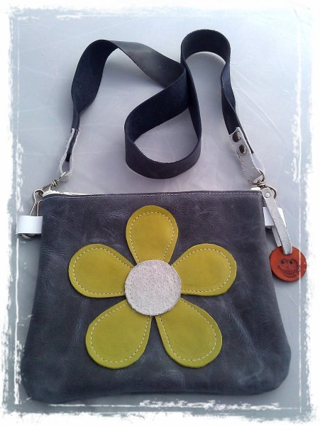 Small leather bag with green flower