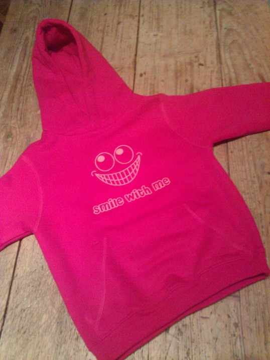 Smile with me on a hooded sweater