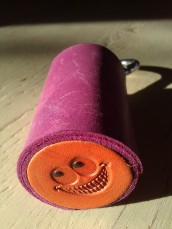 Leather Olloclip lens case purple and orange with a smile
