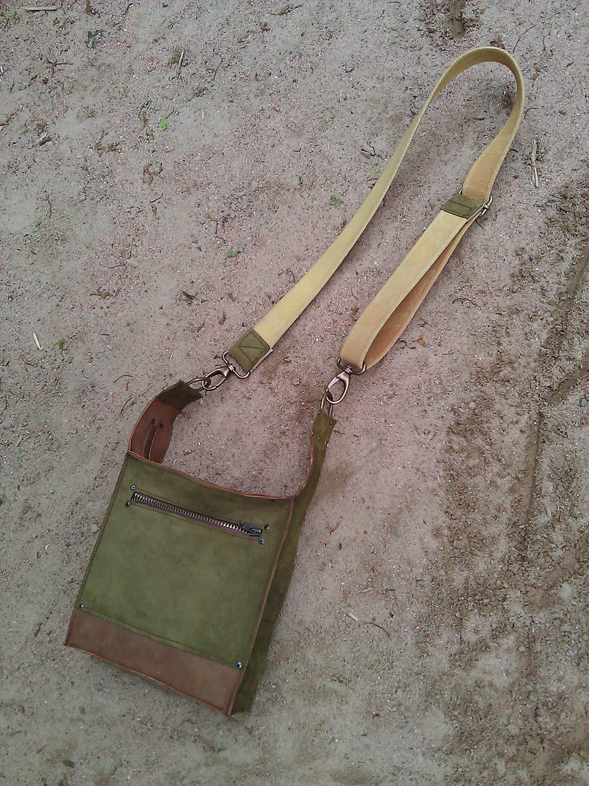 Handmade leather bag in the sand