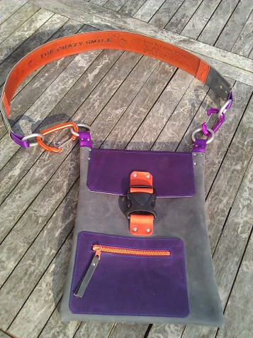 Handmade Leather Bag with tooled strap on table