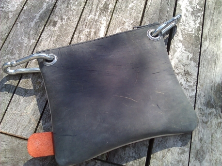 Handmade leather bag with eyelets back
