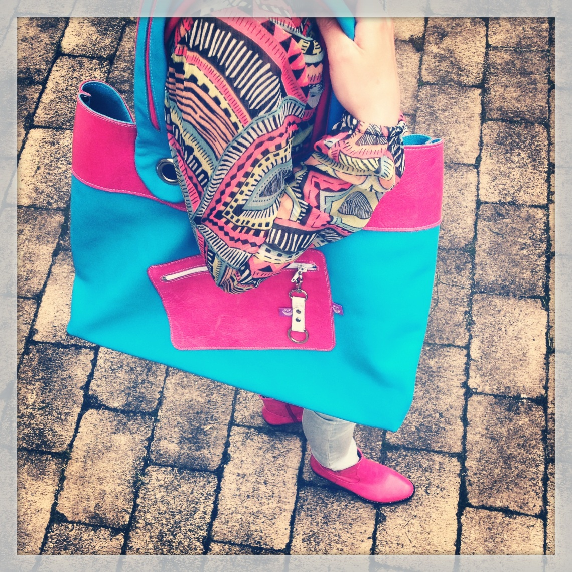Pink and Blue leather bag in action