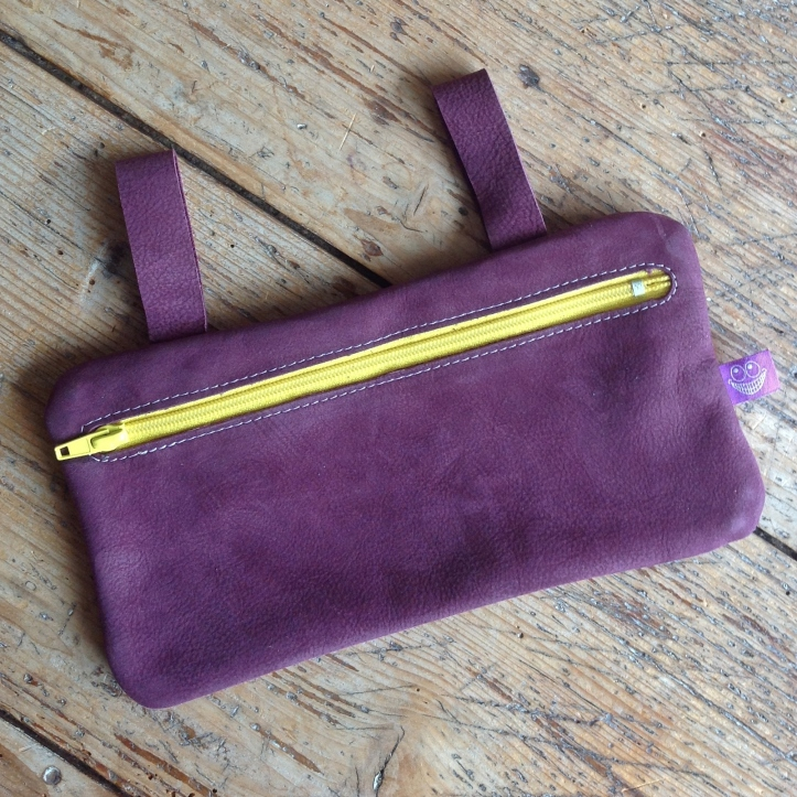 Purple leather etui with yellow zipper