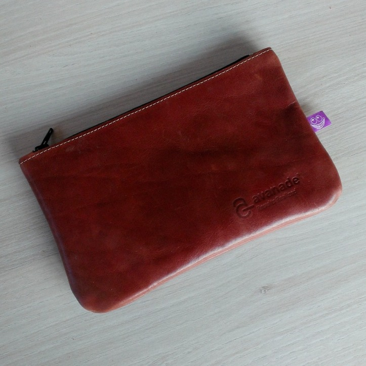 Handmade leather etui with Avanade logo
