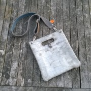 Raw leather bag front