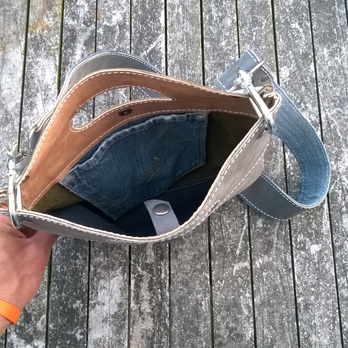 Raw leather bag inside
