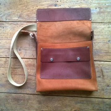 Brown leather bag open