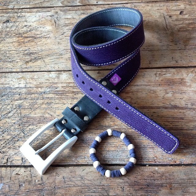 Purple leather belt with white buckle