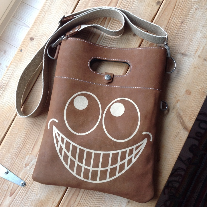 Leather bag with a big smile