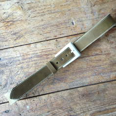 Green leather belt with white buckle