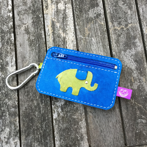 Little blue and green wallet with elephant back