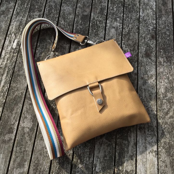 Recycled couch to leather bag
