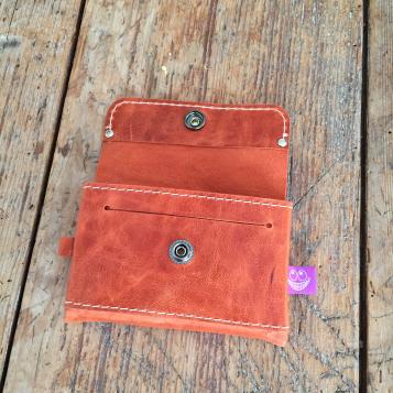 Orange leather wallet open