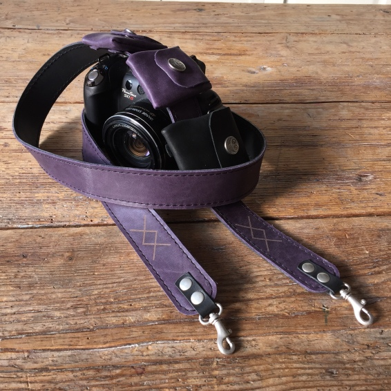 Camera strap with sd and battery pockets