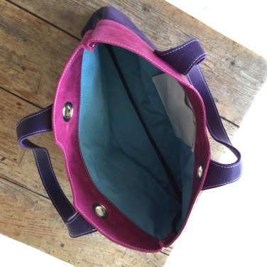 Purple and pink leather bag inside