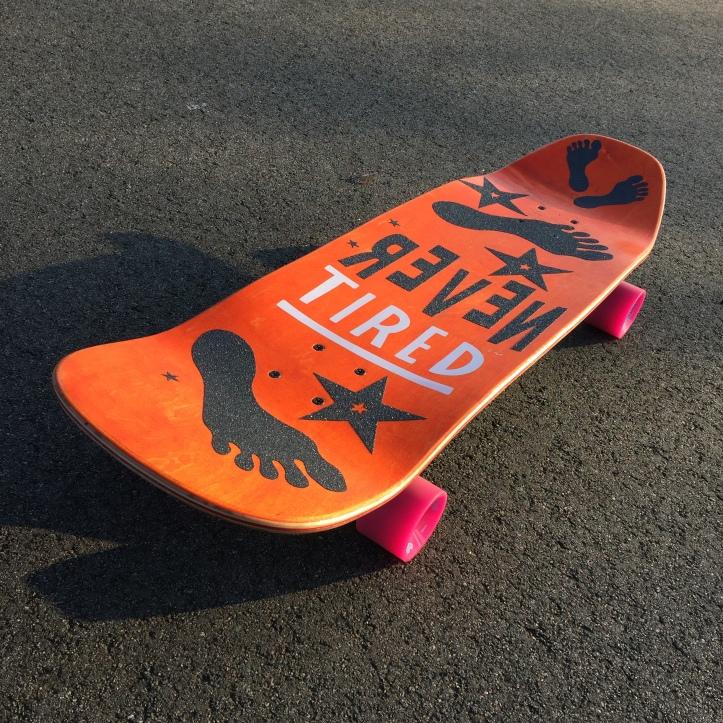 Skateboard with laser cut griptape