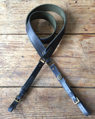 Grey and green leather camera strap
