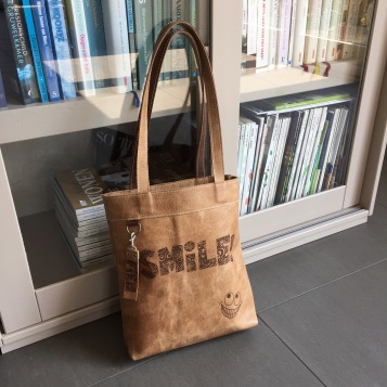 Leather bag with laserengraving Smile