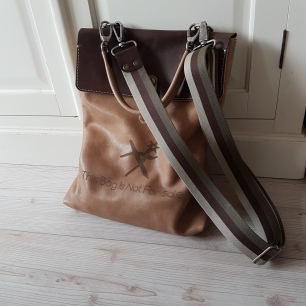Bag with logo and shoulder strap